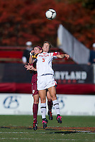 Kristen Schmidbauer (5) of Maryland goes up for a header with Isabella Schmid (11) of Florida State during the game at Ludwing Field in College Park, MD.  Florida State defeated Maryland, 1-0.