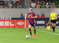 AUSTIN, TX - JUNE 16: Megan Rapinoe #15 of the United States looks to pass the ball during a game between Nigeria and USWNT at Q2 Stadium on June 16, 2021 in Austin, Texas.