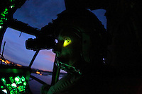 Pilot Bjørn Bottolfsen in the cockpit, using night vision goggles. Crew from Norwegian Air Force 330 squadron, flying Westland Sea King helicopter. The core mission of the squadron is SAR (search and rescue), but they also fly HEMS (Helicopter Emergency Medical Service), complementing the civilian air ambulance service.<br />