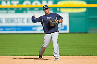 Tampa Bay Rays shortstop Yunel Escobar (11) makes a throw to first base during batting practice prior to the game against the Detroit Tigers at Comerica Park on June 4, 2013 in Detroit, Michigan.  The Tigers defeated the Rays 10-1.  Brian Westerholt/Four Seam Images