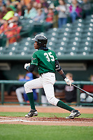 Great Lakes Loons shortstop Oneil Cruz (35) follows through on a swing during a game against the Burlington Bees on May 4, 2017 at Dow Diamond in Midland, Michigan.  Great Lakes defeated Burlington 2-1.  (Mike Janes/Four Seam Images)