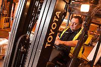 Loader Tony Horan on his fork lift