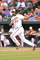 Baltimore Orioles left fielder Delmon Young #27 swings at a pitch during a game against the New York Yankees at Oriole Park at Camden Yards August 11, 2014 in Baltimore, Maryland. The Orioles defeated the Yankees 11-3. (Tony Farlow/Four Seam Images)