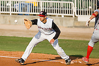 First baseman Christian Marrero (24) of the Kannapolis Intimidators stretches for a throw at Fieldcrest Cannon Stadium in Kannapolis, NC, Sunday, May 11, 2008.