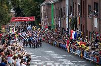 peloton making it's way up the Wijnpersstraat cheered on by a roaring crowd.<br /> <br /> Elite Men World Championships - Road Race<br /> from Antwerp to Leuven (268.3km)<br /> <br /> UCI Road World Championships - Flanders Belgium 2021<br /> <br /> ©kramon