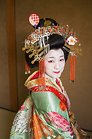Japan, Kyoto. A Japanese Tayu, the highest rank of courtesan. Well versed in reading, tea ceremony, music & dance. More elaborate than a Geisha, fewer than five Tayu, exist today.