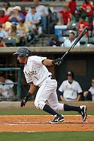 Charleston RiverDogs infielder Jose Javier (1) at bat during a game against the Augusta GreenJackets at Joseph P.Riley Jr. Ballpark on April 15, 2015 in Charleston, South Carolina. Charleston defeated Augusta 8-0. (Robert Gurganus/Four Seam Images)