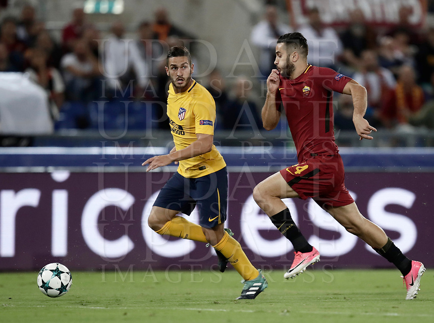 Football Soccer: UEFA Champions League AS Roma vs Atletico Madrid Stadio Olimpico Rome, Italy, September 12, 2017. <br /> Atletico Madrid's Koke (l) in action with Roma's Kostas Manolas (r) during the Uefa Champions League football soccer match between AS Roma and Atletico Madrid at at Rome's Olympic stadium, September 12, 2017.<br /> UPDATE IMAGES PRESS/Isabella Bonotto