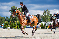 AUS-Kevin McNab rides Scuderia 1918 Don Quidam during the Prizegiving for the Meßmer Trophy mit Deutscher Meisterschaft CCI4*-S. Final-7th. The Longines Luhmuehlen International Horse Trials. Salzhausen, Germany. Sunday 16 June. Copyright Photo: Libby Law Photography