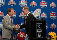 LSU Head Coach Les Miles and Alabama Head Coach Nick Saban shake hands together after group pictures with BCS National Championship Trophy during BCS National Championship Head Coaches Press Conference at Marriott Hotel at the Convention Center on January 8th, 2012.