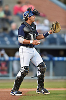 Asheville Tourists catcher Jose Briceno #4 during a game against the Rome Braves at McCormick Field on May 1, 2014 in Asheville, North Carolina. The Tourists defeated the Braves 8-7. (Tony Farlow/Four Seam Images)