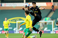 20th April 2021; Carrow Road, Norwich, Norfolk, England, English Football League Championship Football, Norwich versus Watford; Adam Masina of Watford with a hig boot on Aarons as he attempts to control a high ball