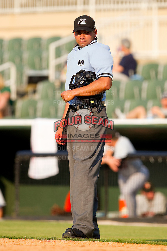 Home plate umpire Roberto Ortiz between innings of the South Atlantic League game between the Delmarva Shorebirds and the Kannapolis Intimidators at Fieldcrest Cannon Stadium on May 22, 2011 in Kannapolis, North Carolina.   Photo by Brian Westerholt / Four Seam Images