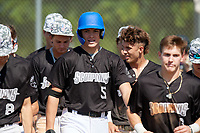 Sean Sparling (5) congregated by teammates after hitting a home run during the WWBA World Championship at Terry Park on October 8, 2020 in Fort Myers, Florida.  Sean Sparling, a resident of Palm Coast, Florida who attends Matanzas High School, is committed to Daytona State College.  (Mike Janes/Four Seam Images)
