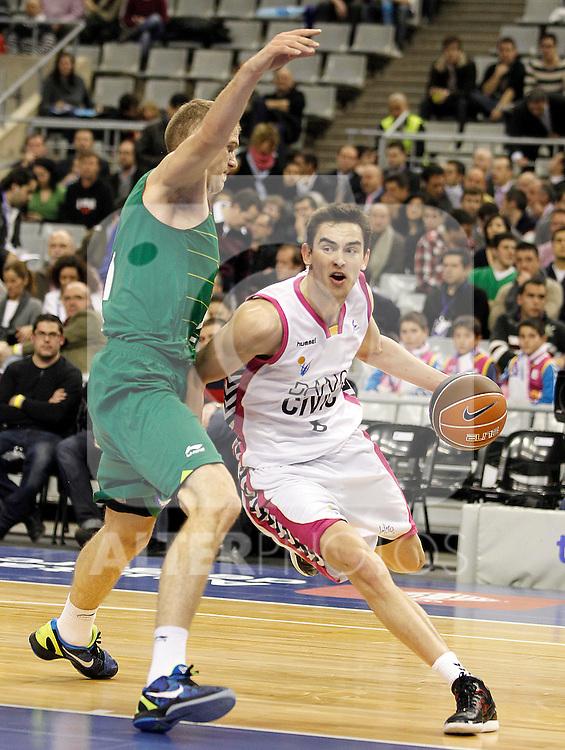 Unicaja Malaga's Luka Zoric (l) and Banca Civica Sevilla's Tomas Satoransky during Spanish Basketball King's Cup match.February 17,2012. (ALTERPHOTOS/ALFAQUI/Acero)