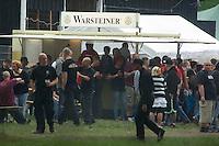 """Mehrere hundert Rechtsradikale aus ganz Deutschland kamen am Samstag den 18. Mai 2013 zu einem sog. Rechtsrock-Konzert nach Finowfurt in Brandenburg. Sie versammelten sich auf dem Gelaende des Neonazis Klaus Mann. Klaus Mann, einstiger Brandenburger DVU-Chef, veranstaltet seit laengerem Neonazi-Konzerte, dieses sollte mit 13 geplanten Bandauftritten das bislang groesste werden. Das Konzert wurde als Benefitzkonzert mit dem Motto """"EINER fuer alle, alle fuer einen"""" beworben, womit nach Insiderangaben der mutmassliche NSU-Unterstuetzer Ralf Wohlleben gemeint ist. <br />Die Polizei loeste das Konzert gegen 21.00 Uhr auf, nachdem Neonazis mehrfach den Hitlergruss gezeigt hatten.<br />18.5.2013, Finowfurt<br />Copyright: Christian-Ditsch.de<br />[Inhaltsveraendernde Manipulation des Fotos nur nach ausdruecklicher Genehmigung des Fotografen. Vereinbarungen ueber Abtretung von Persoenlichkeitsrechten/Model Release der abgebildeten Person/Personen liegen nicht vor. NO MODEL RELEASE! Don't publish without copyright Christian-Ditsch.de, Veroeffentlichung nur mit Fotografennennung, sowie gegen Honorar, MwSt. und Beleg. Konto:, I N G - D i B a, IBAN DE58500105175400192269, BIC INGDDEFFXXX, Kontakt: post@christian-ditsch.de<br />Urhebervermerk wird gemaess Paragraph 13 UHG verlangt.]"""