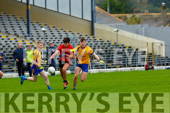 JAck Brosnan Glenbeigh-Glencar goes past Sean O'Brien Beaufort during their Club Intermediate qf in Fitzgerald Stadium on Sunday