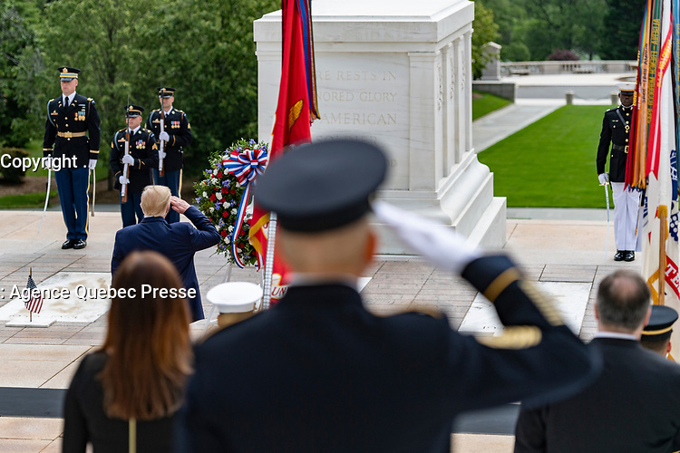 President Donald Trump renders honors during a Presidential Armed Forces Full Honors Wreath-Laying Ceremony in observance of Memorial Day at Arlington National Cemetery, Arlington, Virginia, May 25, 2020. This was the 152nd Memorial Day wreath-laying and observance ceremony at Arlington National Cemetery. (U.S. Army photo by Elizabeth Fraser / Arlington National Cemetery / released)