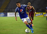 IBAGUE - COLOMBIA, 06-10-2020: Cristian Arango de Millonarios en acción durante el partido entre Deportes Tolima y Millonarios por la fecha 12 de la Liga BetPlay DIMAYOR 2020 jugado en el estadio Manuel Murillo Toro de la ciudad de Ibagué. / Cristian Arango of Millonarios in action during match for the date 12 between Deportes Tolima and Millonarios of BetPlay DIMAYOR League 2020 played at Manuel Murillo Toro stadium in Ibague city.  Photo: VizzorImage / Joan Stiven Orjuela / Cont