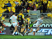 Fans celebrate as TJ Perenara saves a try during the Super Rugby semifinal match between the Hurricanes and Chiefs at Westpac Stadium, Wellington, New Zealand on Saturday, 30 July 2016. Photo: Dave Lintott / lintottphoto.co.nz