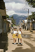 Two schoolgirls in the southern town of Trinidad, which was declared a World Heritage site by UNESCO in 1988 to preserve the architectural legacy of its Spanish colonial history.