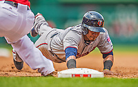 9 June 2013: Minnesota Twins infielder Eduardo Escobar dives safely back to first during a pickoff attempt by the Washington Nationals at Nationals Park in Washington, DC. The Nationals shut out the Twins 7-0 in the first game of their day/night double-header. Mandatory Credit: Ed Wolfstein Photo *** RAW (NEF) Image File Available ***