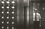 Scan of vintage print. Williamsport National Bank vault with bank official. 1980's. 1/1;