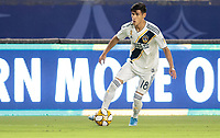 CARSON, CA - SEPTEMBER 21: Uriel Antuna #18 of the Los Angeles Galaxy looks for an open man during a game between Montreal Impact and Los Angeles Galaxy at Dignity Health Sports Park on September 21, 2019 in Carson, California.