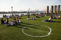 NEW YORK, NY - MAY 15: Groups of people use the circles they held at Domino Park for people to use social distance on May 15, 2020 in Brooklyn, NY. COVID-19 has spread to most countries in the world, claiming more than 303,000 infected lives for more than 4.5 million people, although in some cities the pandemic has controlled deaths and infections continue. Mayor Bill de Blasio says the city, along with New York police, will launch a pilot program in public parks this weekend to monitor crowds (Photo by Pablo Monsalve / VIEWpress via Getty Images)