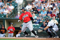 Indianapolis Indians outfielder Jose Tabata #18 bats in front of catcher Francisco Cervelli during a game against the Empire State Yankees at Frontier Field on August 4, 2012 in Rochester, New York.  Empire State defeated Indianapolis 9-8 in ten innings.  (Mike Janes/Four Seam Images)