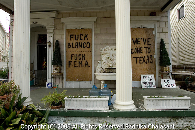 New Orleans-September 17: Spray painted messages on a boarded up home along Esplanade Ave. express the anger that many feel towards government organizations and politicians over the lack of adequate response to Hurricane Katrina September 17, 2005 in New Orleans. Residents started returning home this weekend for the most part to check on their properties and assess damages rather than to stay since much of the city remains without power or drinking water. (Photo By Radhika Chalasani/Getty Images)