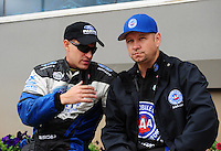 Sept. 18, 2011; Concord, NC, USA: NHRA funny car driver Bob Tasca III (left) talks with Robert Hight during the O'Reilly Auto Parts Nationals at zMax Dragway. Mandatory Credit: Mark J. Rebilas-