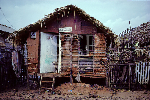 Sao Luis, Maranhao State, Brazil; dilapidated mud and wattle house with sign 'Vende-se Esta Casa' - 'This House is For Sale'.