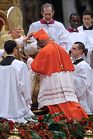 Zambian newly appointed Cardinal Medardo Joseph Mazombwe (R) gets his biretta, the square red hat symbolising the blood of the martyrs, from Pope Benedict XVI (L) on November 20, 2010 during a consistory at St Peter's basilica at The Vatican. 24 Roman Catholic prelates join today the Vatican's College of Cardinals, the elite body that advises the pontiff and elects his successor upon his death.