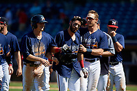 Mississippi Braves Alejandro Salazar (center) is congratulated by teammates Connor Lien (right) and Drew Waters (left) after laying down a bunt for a walk-off squeeze play during a Southern League game against the Jacksonville Jumbo Shrimp on May 5, 2019 at Trustmark Park in Pearl, Mississippi.  Mississippi defeated Jacksonville 1-0 in ten innings.  (Mike Janes/Four Seam Images)