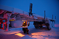 A worker, at a camp set up by oil and gas prospecting company Siesmorevzedka in the Arctic tundra, repairs his truck. /Felix Features