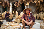 """Villagers sit and weave intricate baskets by hand in a quiet courtyard.  Workers in this Vietnamese village have been making the bamboo containers this way for the past 200 years.<br /> <br /> Amateur photographer Đình Chính Nghiêm, who captured the images in the Thu Sy commune in the Hung Yen province of Vietnam, said a skilled worker will take less an hour to make a whole basket.  The 23-year-old, from Dong Anh Town, in Hanoi, Vietnam, added: """"The baskets are used for many purposes such as fishing, keeping chickens, and decoration.  SEE OUR COPY FOR DETAILS.<br /> <br /> Please byline: Nghiem Dinh Chinh/Solent News<br /> <br /> © Nghiem Dinh Chinh/Solent News & Photo Agency<br /> UK +44 (0) 2380 458800"""