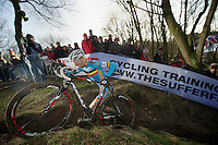 Michael Vanthourenhout (BEL) conquering the steepest climb on the course<br /> <br /> 2014 UCI cyclo-cross World Championships, Men U23