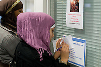 A prospective student fills in an application form, Open Day at Kingston College when prospective students and their parents look around.