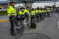 BOGOTA, COLOMBIA - APRIL 28 : National police officers stand guard during a national strike Against the Duque package and the tax reform on April 28, 2021 in Bogota, Colombia. Colombia has the minimum wage around $ 250 per month where people are unhappy about corruption, unemployment, and inequality by Government. (Photo by Leonardo Munoz/VIEWpress)