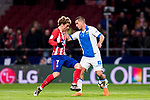 Antoine Griezmann (L) of Atletico de Madrid fights for the ball with Gabriel Appelt Pires of CD Leganes during the La Liga 2017-18 match between Atletico de Madrid and CD Leganes at Wanda Metropolitano on February 28 2018 in Madrid, Spain. Photo by Diego Souto / Power Sport Images