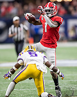 ATLANTA, GA - DECEMBER 7: George Pickens #1 of the Georgia Bulldogs leaps over Kary Vincent Jr. #5 of the LSU Tigers during a game between Georgia Bulldogs and LSU Tigers at Mercedes Benz Stadium on December 7, 2019 in Atlanta, Georgia.
