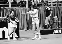 1978,Netherlands,ABN tennis Tournament, Rotterdam,Ilie Nastase (ROU) sasking ballgirl to play for him