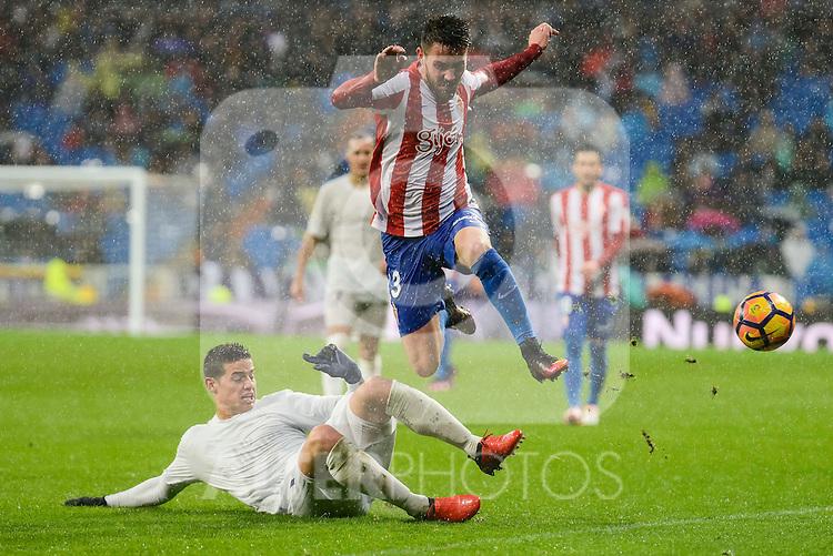 Real Madrid's player James Rodriguez and Sporting de Gijon's player Moi Gonzalez during match of La Liga between Real Madrid and Sporting de Gijon at Santiago Bernabeu Stadium in Madrid, Spain. November 26, 2016. (ALTERPHOTOS/BorjaB.Hojas)