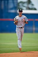 GCL Marlins center fielder Connor Scott (24) jogs back to the dugout during a game against the GCL Mets on August 3, 2018 at St. Lucie Sports Complex in Port St. Lucie, Florida.  GCL Mets defeated GCL Marlins 3-2.  (Mike Janes/Four Seam Images)