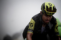 Esteban Chavez (COL/Mitchelton-Scott) up the extremely wet, cold & misty Cole di Mortirolo <br /> <br /> Stage 16: Lovere to Ponte di Legno (194km)<br /> 102nd Giro d'Italia 2019<br /> <br /> ©kramon