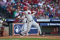 Jacob Nesbit (5) of the Arkansas Razorbacks follows through on his swing against the Oklahoma Sooners in game two of the 2020 Shriners Hospitals for Children College Classic at Minute Maid Park on February 28, 2020 in Houston, Texas. The Sooners defeated the Razorbacks 6-3. (Brian Westerholt/Four Seam Images)