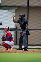Umpire Jaylen Goodman calls a strike during a Gulf Coast League game between the GCL Tigers West and GCL Phillies West on July 27, 2019 at the Carpenter Complex in Clearwater, Florida.  (Mike Janes/Four Seam Images)