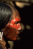Para State, Brazil. Kayapo warrior from A-Ukre village with face paint and bead ear rings at Altamira gathering.