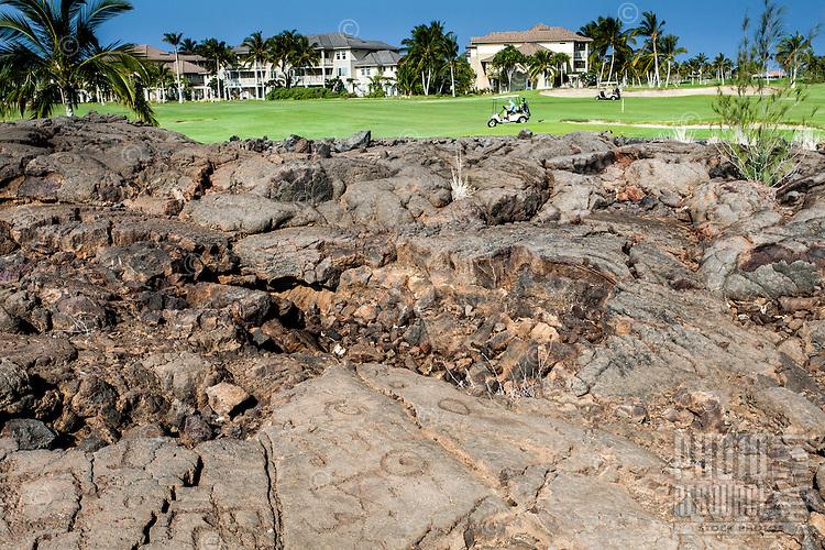 Petroglyphs or ki'i pohaku along the King's Course golf course at the Waikoloa Petroglyph Field (a.k.a. 'Anaeho'omalu Petroglyph Field), Big Island.